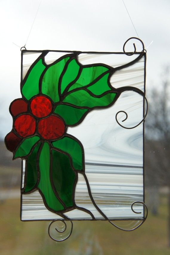 Decorate for the winter season with this suncatcher! The green and red really stand out against the white swirling glass. (approx. 8.5 tall)