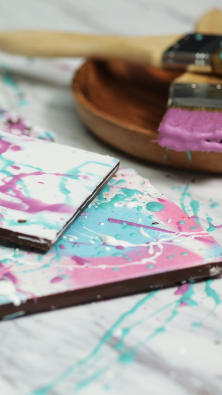 Recipe with video instructions: Show off your artistic side while stepping up your chocolate game. Ingredients: Candy melts (assorted colors), Large chocolate bars, Paint brushes, Acetate sheets or a Silpat, Offset spatula