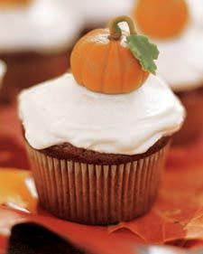 Leslie's favorite cupcakes: pumpkin. I frosted half with maple cream cheese frosting and half with cinnamon cream cheese frosting.