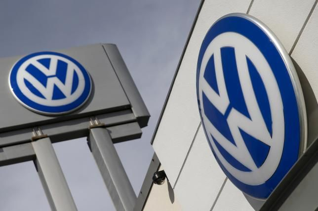 """Factbox: Diesel engines and how VW's """"defeat device' worked?  The logos of German carmaker Volkswagen is seen at a VW dealership in the Queens borough of New York, September 21, 2015.  REUTERS/Shannon Stapleton -"""