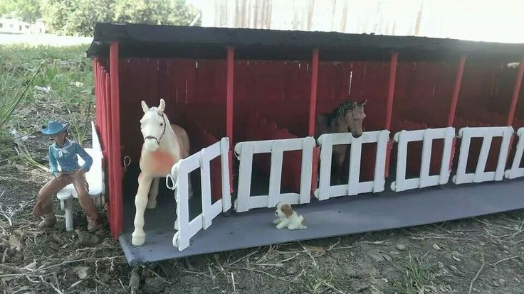 Horse stable I made from popsicle sticks, cardboard, foam board, wooden dowels, and a little floral wire all held together with hot glue!