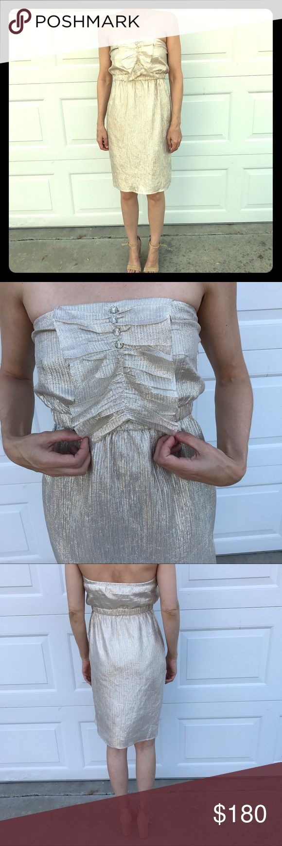 Twelfth  Street Cynthia Vincent Ruffle Strapless Gold and small silver threads run up and down this dress to make it a subdued metallic color. NWT perfect condition. Elastic at waist. Top has elastic in back but not in front. Because my top is so small it would fall on me if I didn't tape. I think it's more of a 2 than a 4 but depending on your chest measurement may need to get top in a bit gorgeous dress to special occasion or going out!!! Definitely gold silver threads are not as prominent…