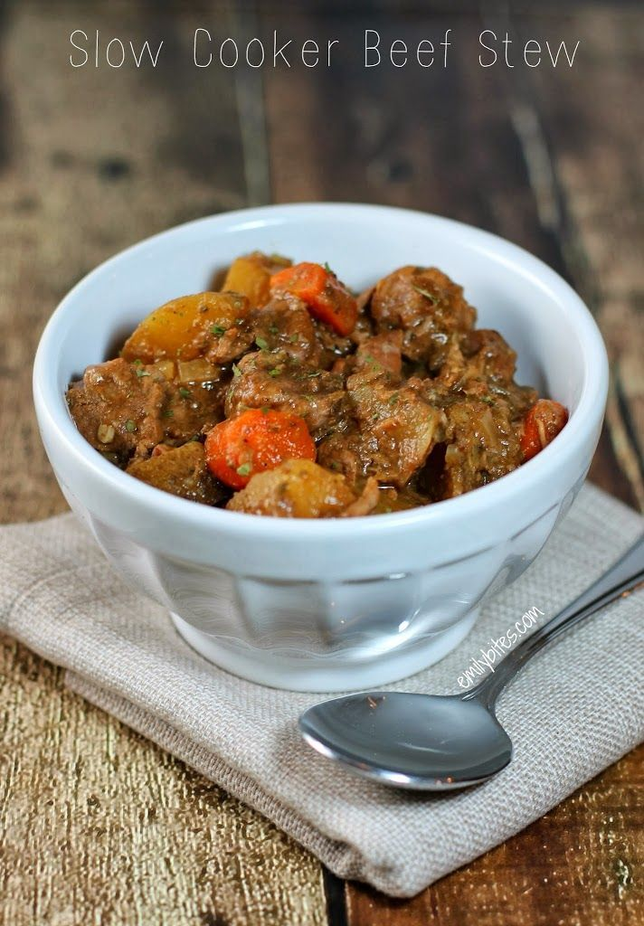 Slow Cooker Beef Stew - so easy and delicious! Just cut it up and throw everything in your crock pot. Perfect comfort food for only 356 calories or 8 Weight Watchers points per serving! www.emilybites.com #healthy