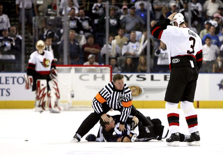 TAMPA, FL - APRIL 25: Referee Kerry Fraser #2 protects Vincent Lecavalier #4 of the Tampa Bay Lightning after fighting with Zdeno Chara #3 of the Ottawa Senators as goaltender Ray Emery #1 watches from the crease in game three of the NHL Eastern Conference quarterfinals on April 25, 2006 at St. Pete Times Forum in Tampa, Florida. The Senators defeated the Lightning 8-4. (Photo by Doug Benc/Getty Images)