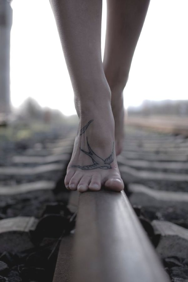 Foot tattoo, beautiful!! Would totally get something like this if I had enough lady balls!