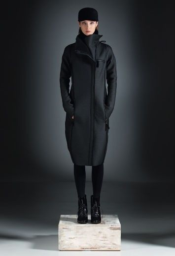 Stunning Annette Gortz 'Hunta' leather look topped wool coat. This coat features a leather look topped wool fabric with a large ribbed jersey collar which has zippered vents, full length sleeves, two zipped side pockets and one zipped left breast pocket.The coat is fastened with a concealed zip fastening and features a ribbed rear hem. This cocoon shaped coat and has a great quirky style to it. This is fabulous for Autumn/Winter '13!