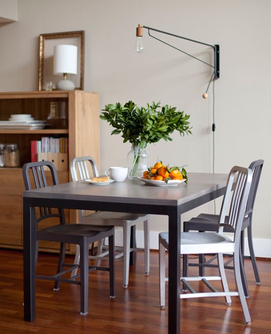 Swing arm wall lamp for the dining table. Image via Apartment 34.