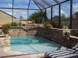 This pool looks like it would be really family friendly. It has a deep end for teens and adults, but is also has a shallow area that is perfect for little kids. I also like the waterfall in that back corner of the pool.