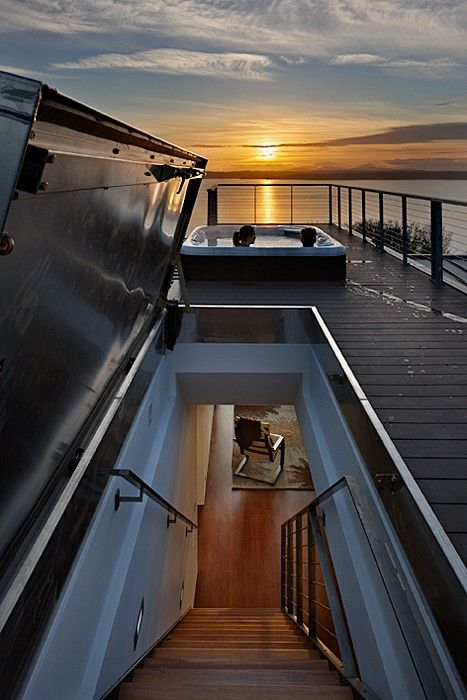 WOW this would be AWESOME if we could have a secret door to a patio above our house! Too cool.