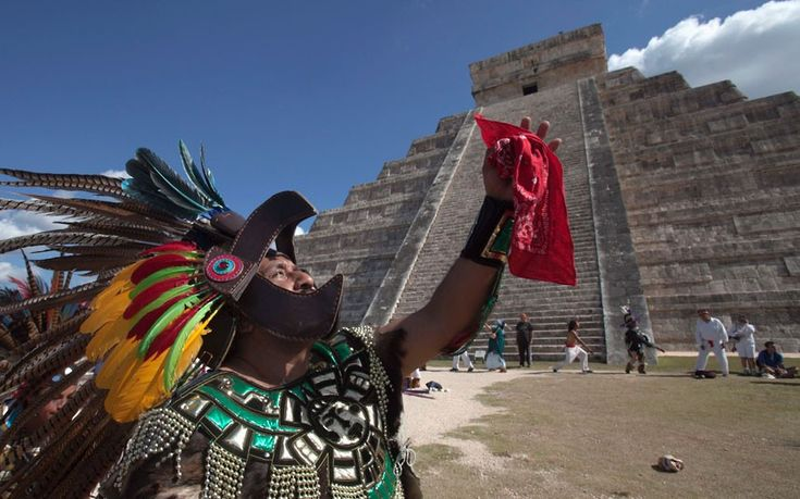 A man in Aztec warrior costume dances in front of the Pyramid of Kukulkan at Chichen Itza in Yucatan state, Mexico  Picture: REUTERS/Victor Ruiz Garcia