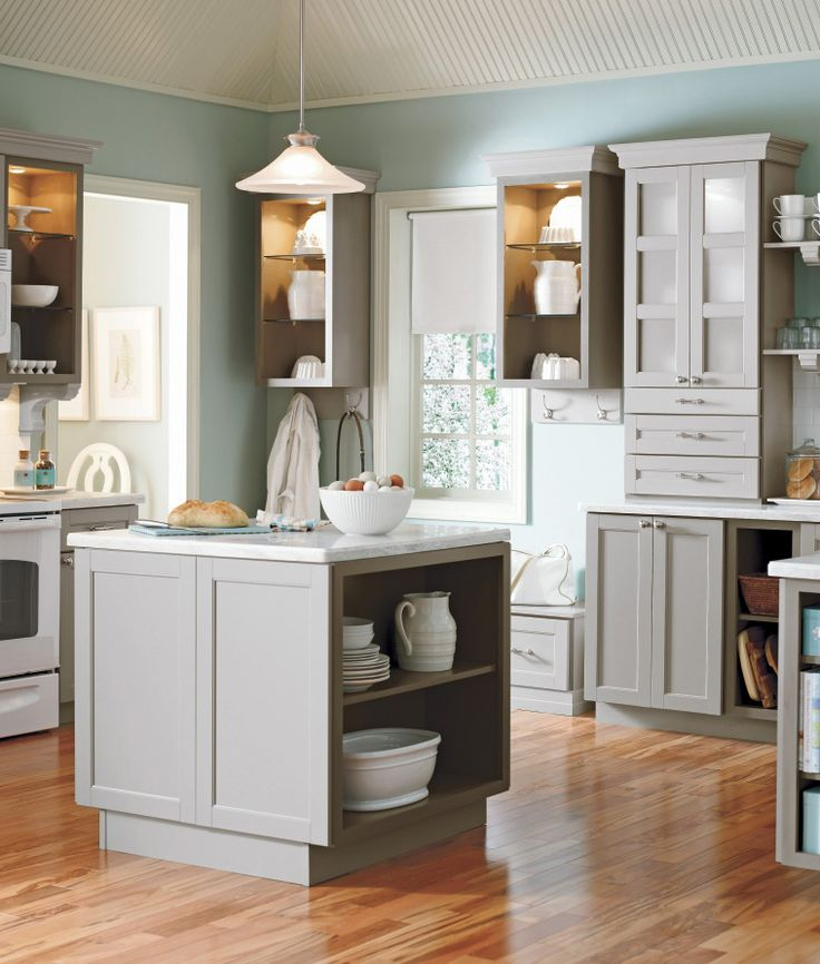 A grey kitchen with open shelving. #kitchens