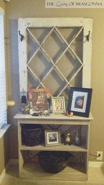 Old door transformed into a Hall Tree / Bookcase.  Love that is was from her great-grandmother's house!