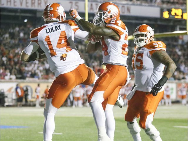 Week 3 - July 6 2017 - BC.23 - MTL. 16 -  British Columbia Lions quarterback Travis Lulay celebrates his game-winning touchdown with running back Jermiah Johnson and Jas Dhillon during fourth quarter of Canadian Football League game against the Alouettes in Montreal Thursday July 6, 2017.  JOHN MAHONEY/MONTREAL GAZETTE