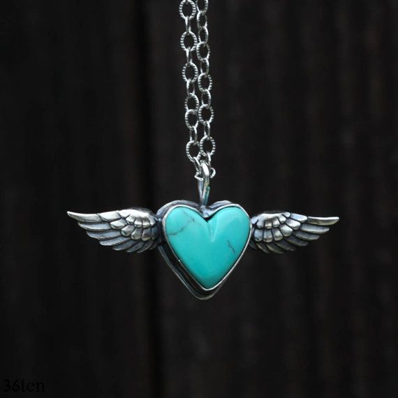 Flying turquoise heart necklace. Sterling silver wings hold this tiny, genuine turquoise heart shaped stone. Whimsical and playful.