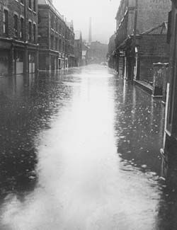 A deserted Market Street, Hebden Bridge, in 1946, looking west.  It was weeks before the flood-water finally subsided.