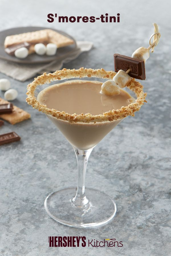S'more Fun can be for adults too with this S'mores-tini. Made with HERSHEY'S Milk Chocolate Bars, marshmallow fluff, and vodka, this delicious cocktail is perfect for your winter holiday party or get together. Must be 21 years or older to enjoy this S'mores occasion.