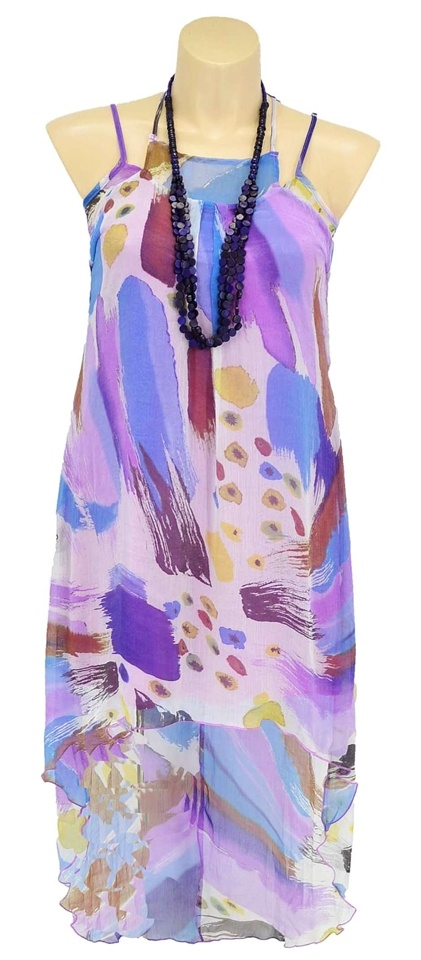 This stylish mixed pattern tunic dress will look fantastic over leggings or pants. Highlights are:- Sheer fabric outside with inside lining- Main colours are purple and blue- Vibrant pattern and bright print- Uneven stylish hem- Fabric is polyester +