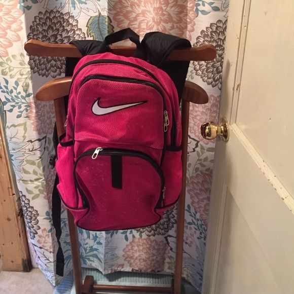 Hot pink Nike mesh backpack Excellent shape. Mesh material great for a day at beach or just to carry your things. Standard backpack sizing. Padded straps. Hot pink and black. No trades. Bundles encouraged. Nike Bags Backpacks