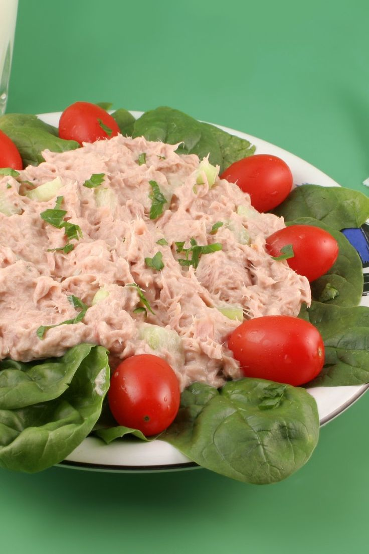 Recipe including course(s): Entrée; and ingredients: black pepper, celery, dijon mustard, fresh parsley, reduced calorie mayonnaise, salt, tuna in water
