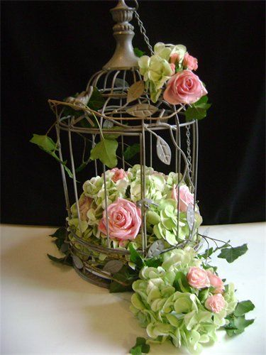 <3 This is my dream bird cage centerpiece - I'd surround it with votive candles and a bird or two