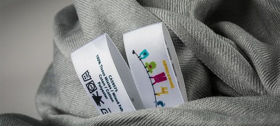 1000 Custom Printed Labels in multicolor. Full Color Printed Satin Care Labels. Washable Labels