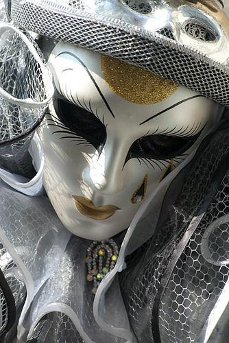 https://flic.kr/p/fkBzpQ | Awesome mask (IMG_3639) | I took this photo on the last weekend of the 2013 Venice Carnavale. There were no planned events so I just spent the day wandering around - the city was mobbed and there were great photo ops all over the place - this was good and bad since it was hard to get the masked characters alone. What a great day in Venice!!