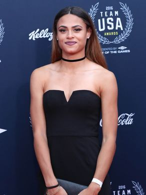 Olympic track athlete Sydney McLaughlin walks the red