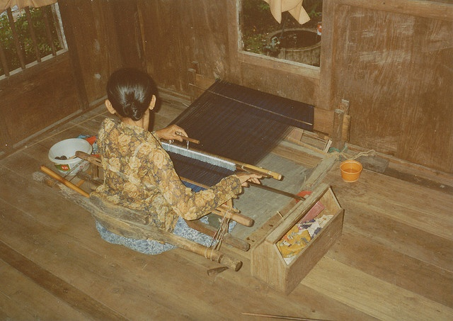 Backstrap loom silk weaving in a Bugis country house in