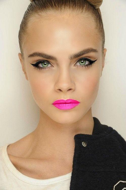 pink lips, winged eyes.