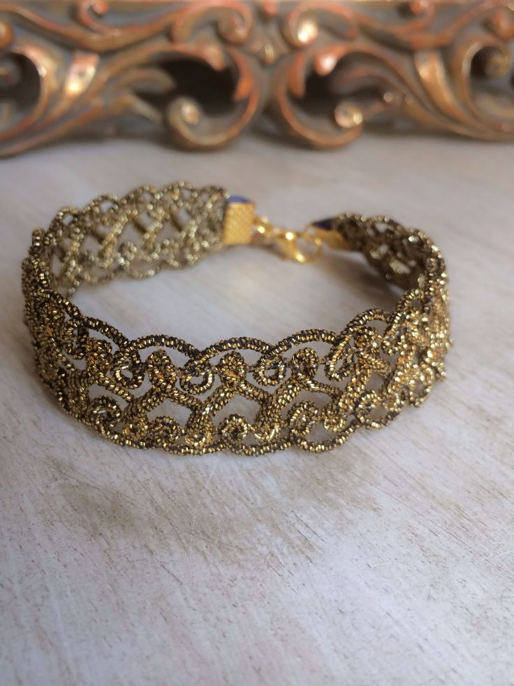 Golden trim bracelet.