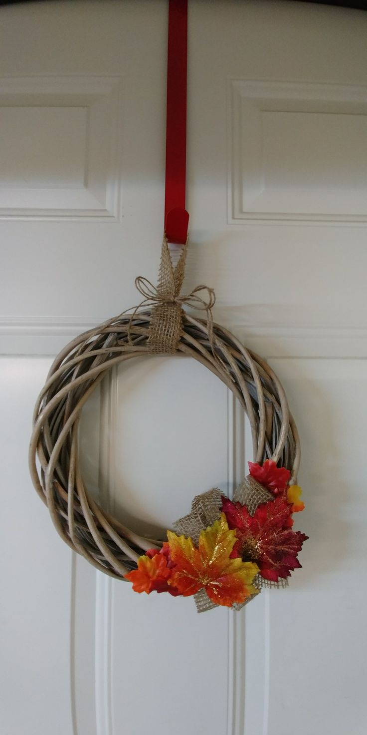Simple DIY Fall Wreath! All materials were either from the dollar store or already on hand at my house. Super easy and cheap way to add DIY fall decor to the home.