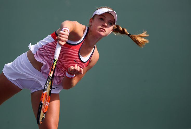Katie Swan Photos - Katie Swan of Great Britain serves in her final qualifying round match against Samantha Crawford of the USA during the Miami Open Presented by Itau at Crandon Park Tennis Center at Crandon Park Tennis Center on March 22, 2016 in Key Biscayne, Florida. - Katie Swan Photos - 123 of 352