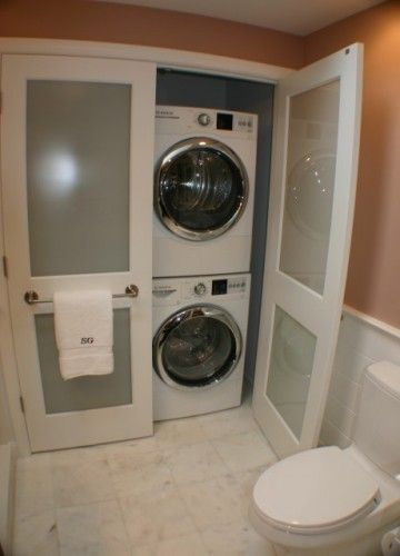 Often laundry area are build with the bathroom.  Why?...I have no idea, but this is the first time I've see a good solution.  You probably have space for a standard washer and dryer.  This features an apartment size.
