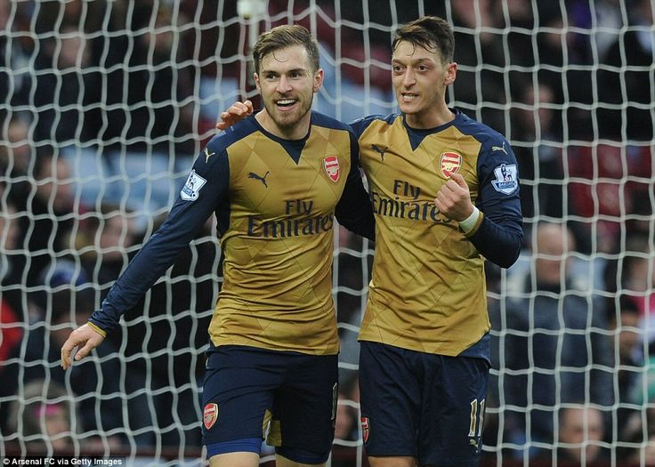 Ozil's ball for Ramsey's goal is the German's 13th Premier League assist for the season as he chases Thierry Henry's record of 20 - celebrating after their 2-0 win at Villa