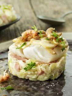 Snijd de prei fijn en stoof kort aan in boter. Snijd de Breydelham in fijne reepjes en voeg toe.Snijd de champignons in schijfjes en bak kort aan in hete olijfolie. Kruid met pezo.Beleg de bodem van de ovenschotel met het Breydelham & prei mengsel.Leg de kabeljauw erop.Mix room en eieren. Kruid met pezo en het kruidentuiltje.Giet over de vis. Leg de champignons erop.