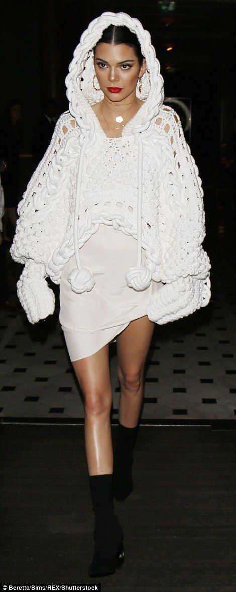 Frayed knot! Earlier in the night, Kendall  slipped into fashion forward cropped oversized knot inspired knit as she attended the LOVE and Burberry London Fashion Week Party at Annabel's