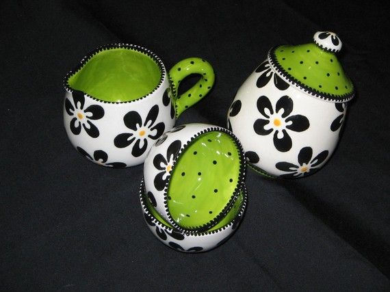 Creamer, sugar, and tea cups - all black and white, with a pop of Parakeet green inside!