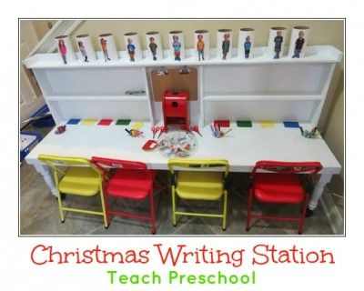 Christmas writing station by Teach Preschool. LOVE the toilet paper tube mailboxes with both photos and written names on them!