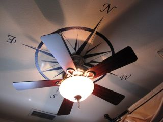 and here is is with the fan, almost cooler.  Wonder if I can find one of those vinyl wall arts to use and avoid painting the ceiling
