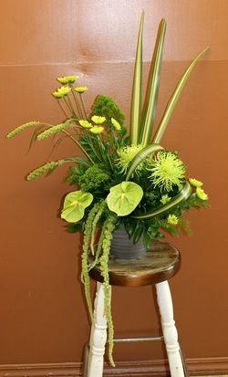 Tropical Green  - Anthurium, spider mums, chrysanthemums, trachelium, millet, amaranthus and tropical leaves.