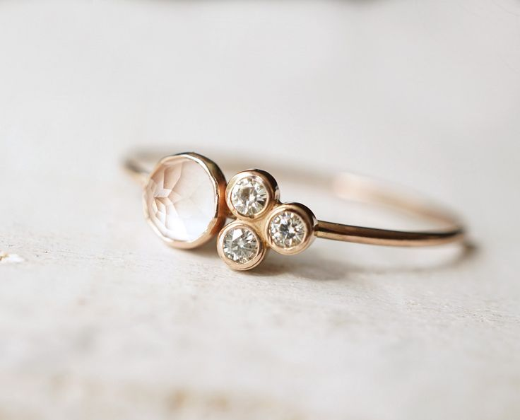 This ring made form recycled 14k gold carries a romantic rose cut rose quartz and 3 tiny moissanites in an exquisite cluster setting. Gift it, keep it and collect it - there is always a reason for thi
