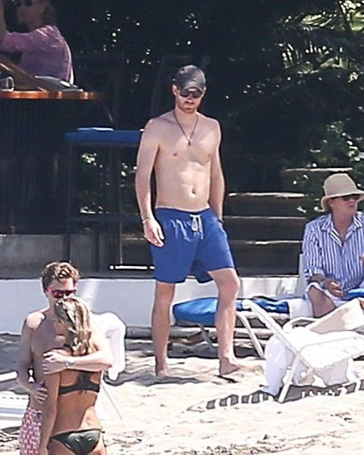 Prince Harry was spotted enjoying the Jamaican sun on the beach with friends after his friend's wedding.