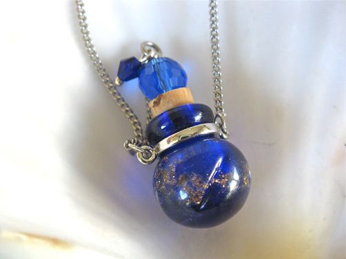 What a unique gift - a necklace with a murano glass pendant containing water from the holy spring at Lourdes, in the south of France