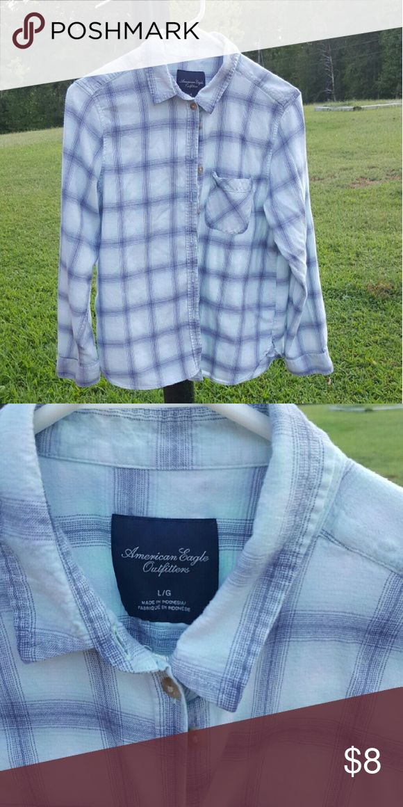 AEO shirt Long sleeve, button up shirt from Americn Eagle. Not flannel and it's in great condition.  Light blue and grey. American Eagle Outfitters Tops Button Down Shirts