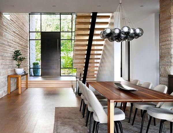 Wood front door with steel window glass surround.  Modern home design