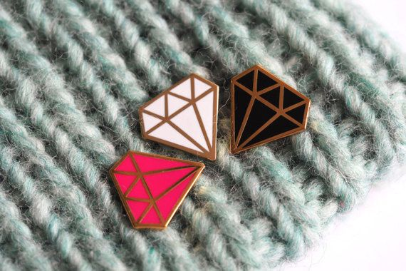 A super glossy hard enamel pin badge, this graphic diamond pin design has a shiny gold finish and is available in bright pink, black or white enamel. They look great on a top, cardi, jacket or bag, I wear mine on my hat :) and make fun and simple gifts for friends, im happy to send packages direct to friends with a little note from you inside....  The pins measure 20mm tall will arrive with a gocco printed tag ready to be worn and enjoyed   I make lots of cute pins which you can see…
