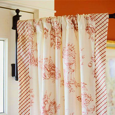 A swinging-arm curtain rod provides a clever solution to draping a French door. Also for those small windows on each side of the front door!! Love it!!