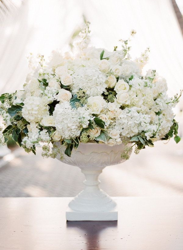 Gorgeous White on White (with greenery) Centerpiece on http://StyleMePretty.com/2012/04/09/naples-wedding-by-kt-merry-photography / Photography by ktmerry.com / Floral Design by 50 Fifty Floral Arty