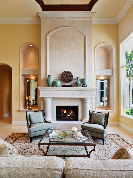 17 best ideas about mediterranean living rooms on for Mediterranean fireplace designs