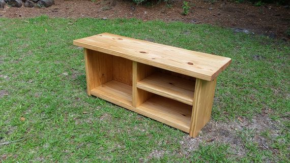 Rustic Wooden Entryway Bench  This Rustic Style Bench is perfect for stopping to put on your boots! Made from solid pine, sanded down just right, then stained in a beautiful Golden Oak. This bench is just the right size for your mudroom, hallway, or laundry room. The bench comes fully assembled with a finished bead board back.  Built to be sturdy and durable with traditional country cottage lines, this bench is a substantial piece of rustic style furniture. Its ready to be passed down…
